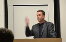 Rick Kupchella with arm raised, is speaking at Minnesota Blogger Conference