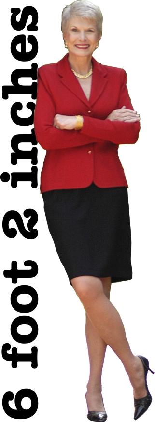 image of Jeanne Robertson in black skirt and red jacket with arms folded. Text alongside says, 6 feet, 2 inches tall.