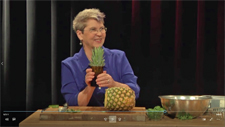 woman cutting a pineapple